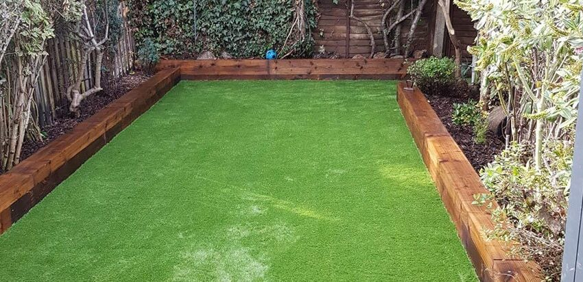 Why do many people use fake grass as a solution to their lawn woes?